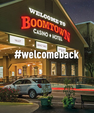 "exterior of Boomtown Casino New Orleans with text ""#welcomeback"""